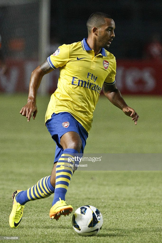 <a gi-track='captionPersonalityLinkClicked' href=/galleries/search?phrase=Theo+Walcott&family=editorial&specificpeople=451535 ng-click='$event.stopPropagation()'>Theo Walcott</a> of Arsenal runs with the ball during the match between Arsenal and the Indonesia All-Stars at Gelora Bung Karno Stadium on July 14, 2013 in Jakarta, Indonesia.