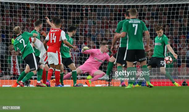 Theo Walcott of Arsenal scores a goal to make it 10 during The Emirates FA Cup QuarterFinal match between Arsenal and Lincoln City at Emirates...