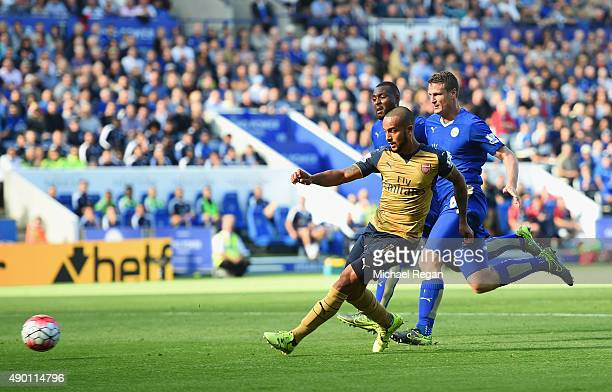 Theo Walcott of Arsenal scores his team's first goal during the Barclays Premier League match between Leicester City and Arsenal at The King Power...