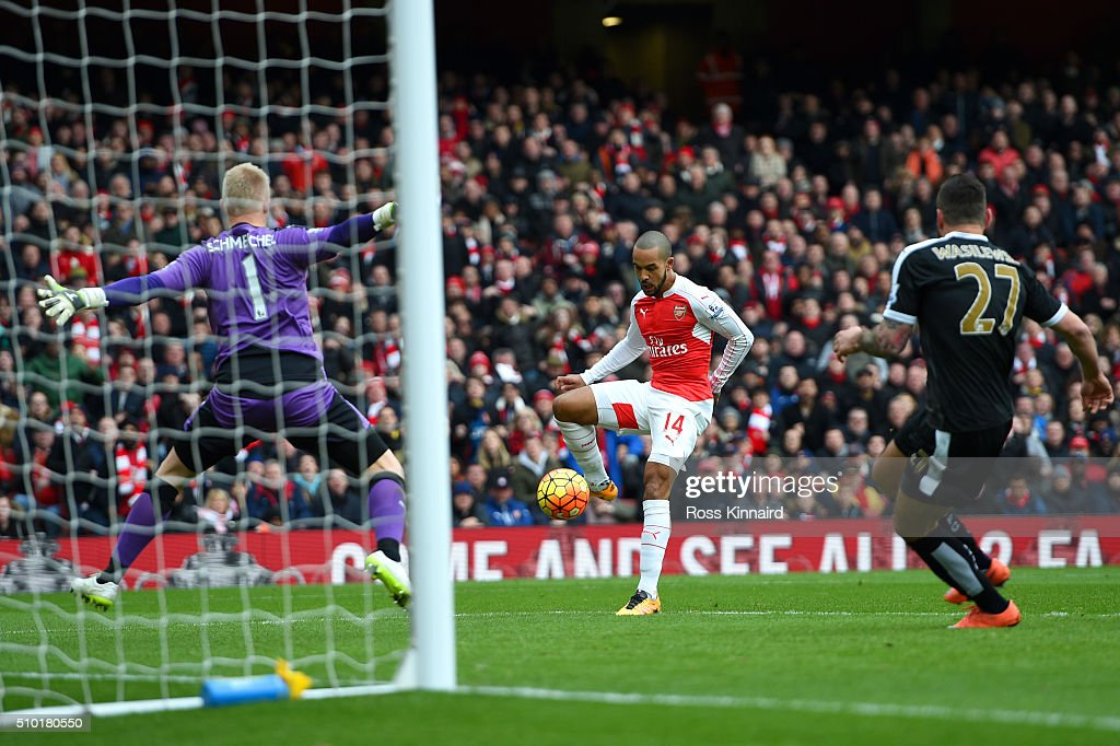 Theo Walcott of Arsenal scores his team's first goal during the Barclays Premier League match between Arsenal and Leicester City at Emirates Stadium on February 14, 2016 in London, England.