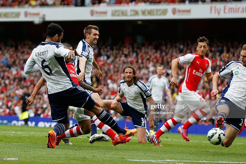Theo Walcott (2nd L, obsured) of Arsenal scores his team's second goal during the Barclays Premier League match between Arsenal and West Bromwich Albion at Emirates Stadium on May 24, 2015 in London, England.
