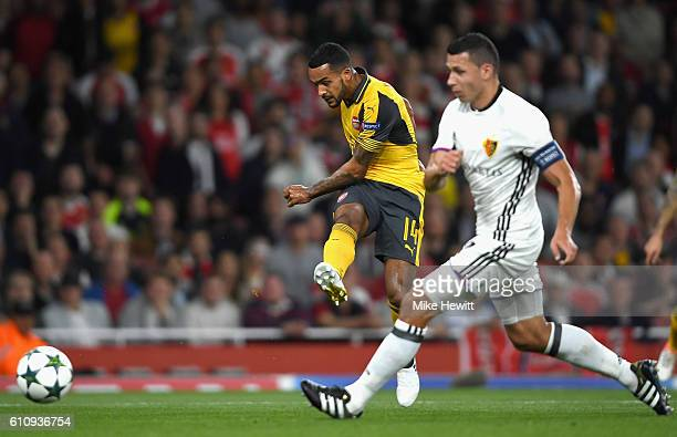Theo Walcott of Arsenal scores his team's second goal during the UEFA Champions League group A match between Arsenal FC and FC Basel 1893 at the...