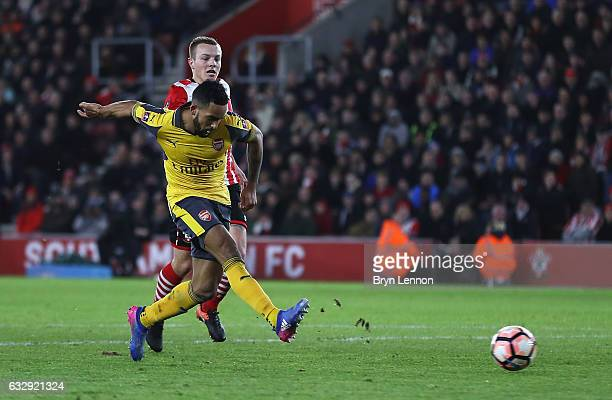 Theo Walcott of Arsenal scores his third and his sides fifth goal during the Emirates FA Cup Fourth Round match between Southampton and Arsenal at St...
