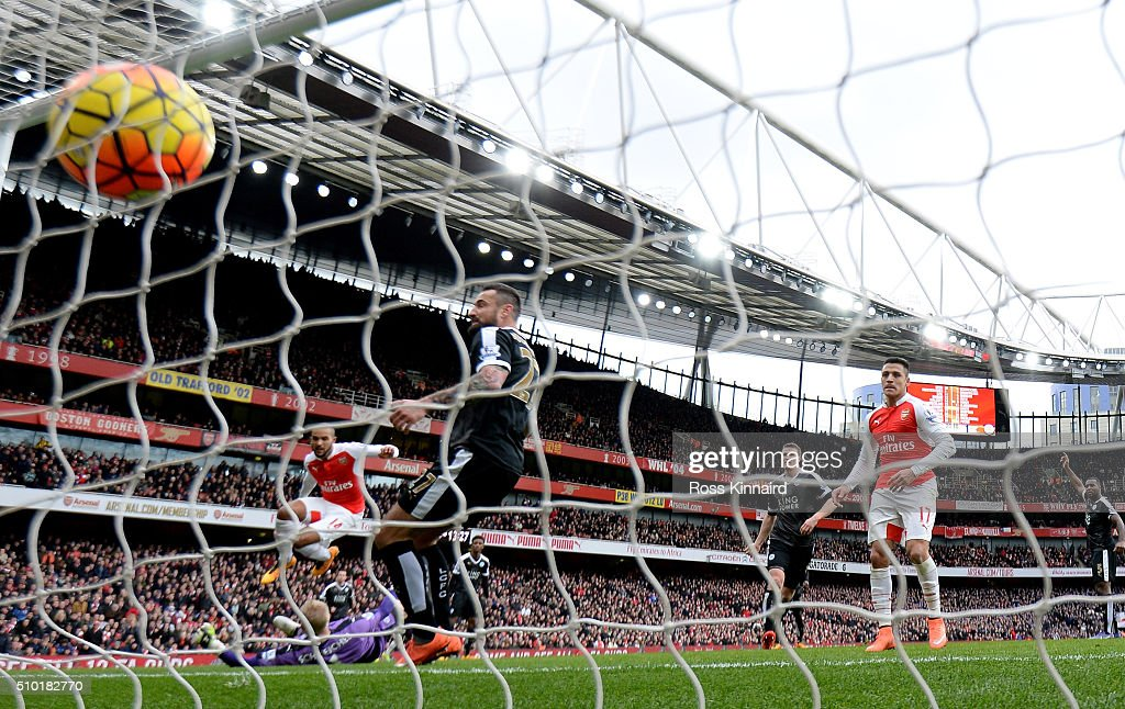 <a gi-track='captionPersonalityLinkClicked' href=/galleries/search?phrase=Theo+Walcott&family=editorial&specificpeople=451535 ng-click='$event.stopPropagation()'>Theo Walcott</a> oF arsenal scores their first goal during the Barclays Premier League match between Arsenal and Leicester City at the Emirates Stadium February 14, 2016 in London, England.