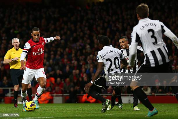 Theo Walcott of Arsenal scores their fourth goal during the Barclays Premier League match between Arsenal and Newcastle United at the Emirates...