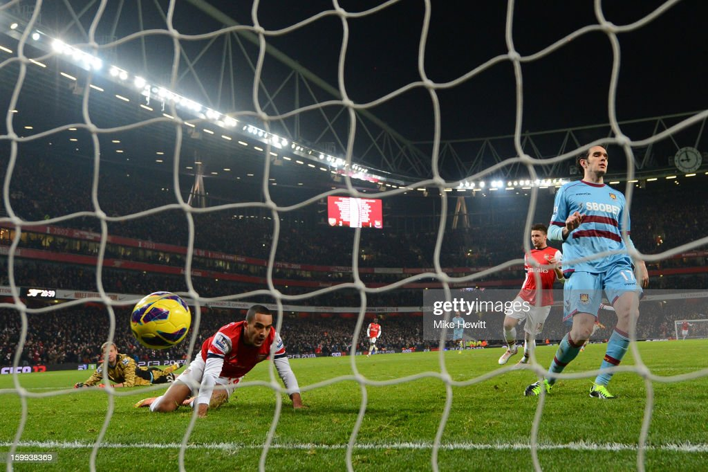 <a gi-track='captionPersonalityLinkClicked' href=/galleries/search?phrase=Theo+Walcott&family=editorial&specificpeople=451535 ng-click='$event.stopPropagation()'>Theo Walcott</a> of Arsenal scores their fourth goal during the Barclays Premier League match between Arsenal and West Ham United at Emirates Stadium on January 23, 2013 in London, England.
