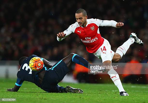 Theo Walcott of Arsenal skips a challenge by Bacary Sagna of Manchester City during the Barclays Premier League match between Arsenal and Manchester...