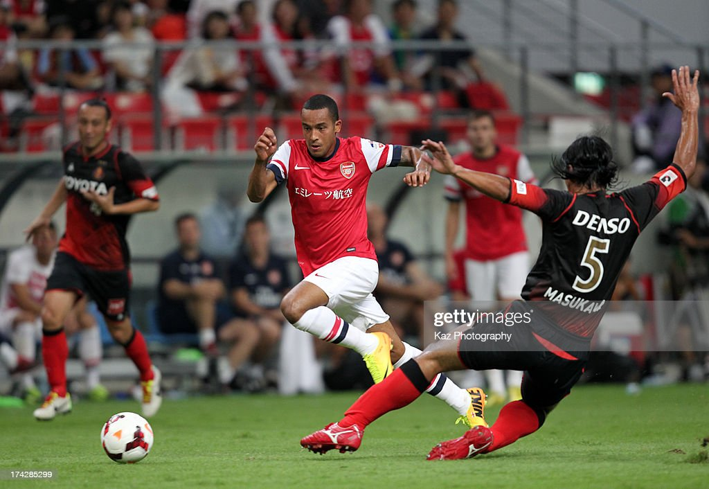 <a gi-track='captionPersonalityLinkClicked' href=/galleries/search?phrase=Theo+Walcott&family=editorial&specificpeople=451535 ng-click='$event.stopPropagation()'>Theo Walcott</a> of Arsenal skips past Takahiro Masukawa of Nagoya Grampus during the pre-season friendly match between Nagoya Grampus and Arsenal at Toyota Stadium on July 22, 2013 in Toyota, Aichi, Japan.