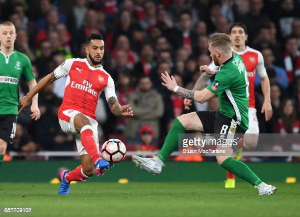 Theo Walcott of Arsenal takes on Alan Power of Lincoln during the Emirates FA Cup QuarterFinal between Arsenal and Lincoln City at Emirates Stadium...