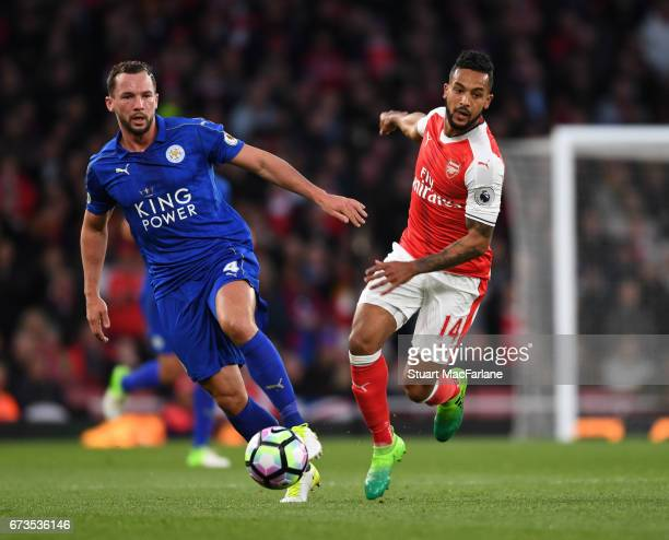 Theo Walcott of Arsenal takes on Danny Drinkwater of Leicester during the Premier League match between Arsenal and Leicester City at Emirates Stadium...