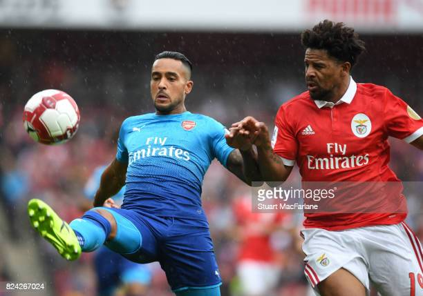 Theo Walcott of Arsenal takes on Eliseu of Benfica during the Emirates Cup match between Arsenal and SL Benfica at Emirates Stadium on July 29 2017...