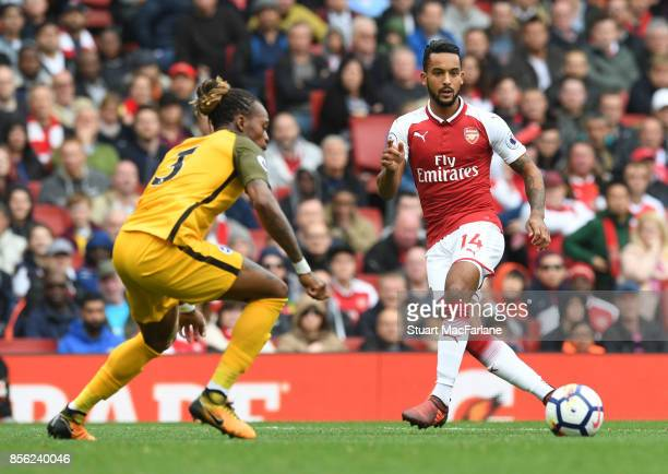 Theo Walcott of Arsenal takes on Gaetan Bong of Brighton during the Premier League match between Arsenal and Brighton and Hove Albion at Emirates...
