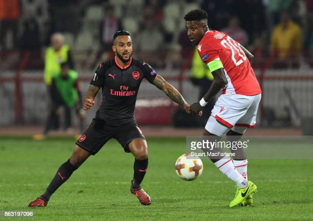 Theo Walcott of Arsenal takes on Mitchell Donald of Red Star during the UEFA Europa League group H match between Crvena Zvezda and Arsenal FC at...