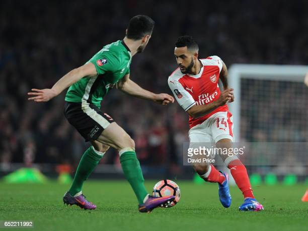 Theo Walcott of Arsenal takes on Sam Habergham of Lincoln during the match between Arsenal and Lincoln City at Emirates Stadium on March 11 2017 in...