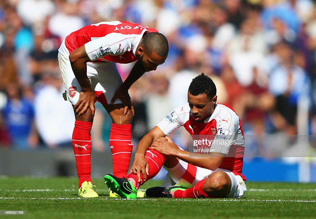 <a gi-track='captionPersonalityLinkClicked' href=/galleries/search?phrase=Theo+Walcott&family=editorial&specificpeople=451535 ng-click='$event.stopPropagation()'>Theo Walcott</a> (L) of Arsenal talks to team mate <a gi-track='captionPersonalityLinkClicked' href=/galleries/search?phrase=Francis+Coquelin&family=editorial&specificpeople=8957797 ng-click='$event.stopPropagation()'>Francis Coquelin</a> (R) during the Barclays Premier League match between Chelsea and Arsenal at Stamford Bridge on September 19, 2015 in London, United Kingdom.