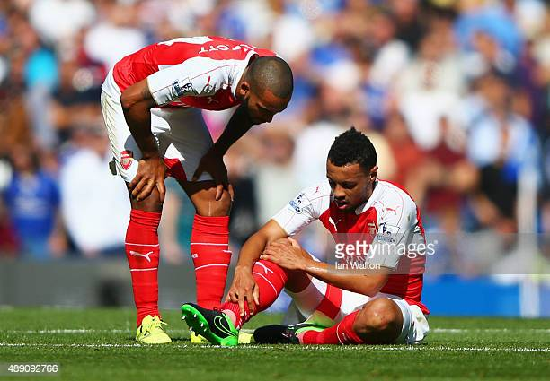 Theo Walcott of Arsenal talks to team mate Francis Coquelin during the Barclays Premier League match between Chelsea and Arsenal at Stamford Bridge...