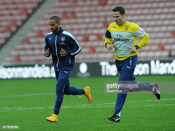Theo Walcott of Arsenal trains with Arsenal Physio Shad Forsythe after the match between Sunderland and Arsenal in the Barclays Premier League at...