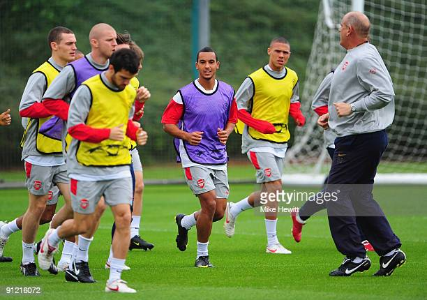 Theo Walcott of Arsenal warms up during a training session in preparation for tomorrow's Champions League Group H match against Olympiacos at London...