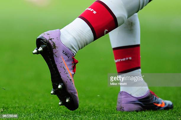 Theo Walcott of Arsenal wears personalised boots during the Barclays Premier League match between Arsenal and Wolverhampton Wanderers at the Emirates...