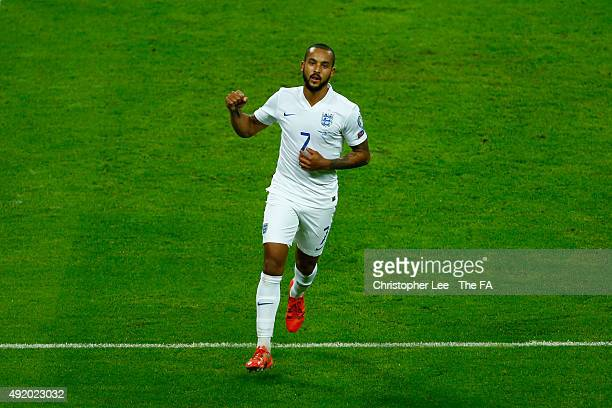 Theo Walcott of England celebrates after scoring the opening goal during the UEFA EURO 2016 Group E Qualifier match between England and Estonia at...
