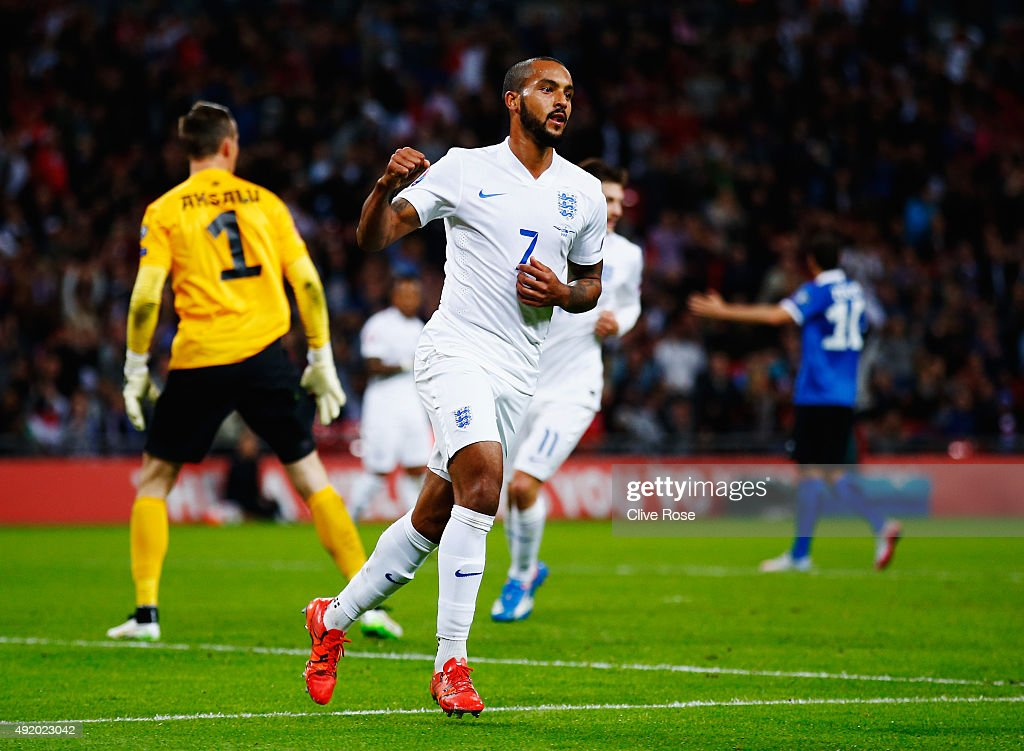 <a gi-track='captionPersonalityLinkClicked' href=/galleries/search?phrase=Theo+Walcott&family=editorial&specificpeople=451535 ng-click='$event.stopPropagation()'>Theo Walcott</a> of England celebrates scoring during the UEFA EURO 2016 Group E qualifying match between England and Estonia at Wembley on October 9, 2015 in London, United Kingdom.