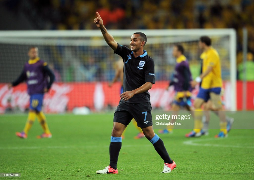 <a gi-track='captionPersonalityLinkClicked' href=/galleries/search?phrase=Theo+Walcott&family=editorial&specificpeople=451535 ng-click='$event.stopPropagation()'>Theo Walcott</a> of England celebrates victory during the UEFA EURO 2012 group D match between Sweden and England at The Olympic Stadium on June 15, 2012 in Kiev, Ukraine.