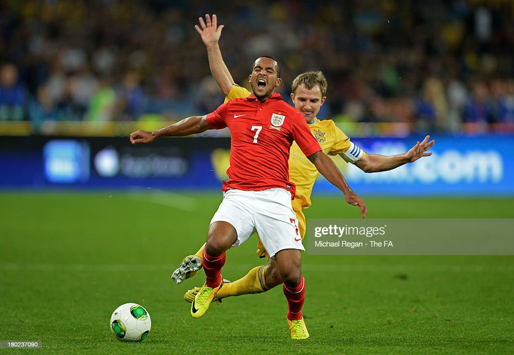 <a gi-track='captionPersonalityLinkClicked' href=/galleries/search?phrase=Theo+Walcott&family=editorial&specificpeople=451535 ng-click='$event.stopPropagation()'>Theo Walcott</a> of England cries out in pain after he is brought down by <a gi-track='captionPersonalityLinkClicked' href=/galleries/search?phrase=Oleksandr+Kucher&family=editorial&specificpeople=3955355 ng-click='$event.stopPropagation()'>Oleksandr Kucher</a> of Ukraine during the FIFA 2014 World Cup Qualifying Group H match between Ukraine and England at the Olympic Stadium on September 10, 2013 in Kiev, Ukraine.