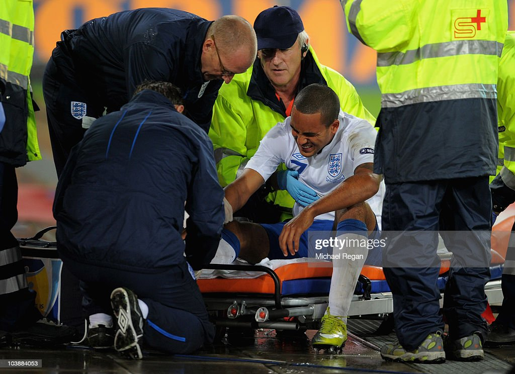 Theo Walcott of England is stretchered off injured during the UEFA EURO 2012 Group G Qualifier between Switzerland and England at St Jakob Park on September 7, 2010 in Basel, Switzerland.