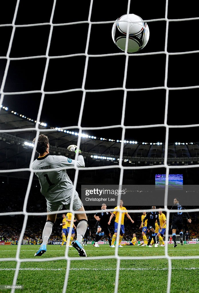 <a gi-track='captionPersonalityLinkClicked' href=/galleries/search?phrase=Theo+Walcott&family=editorial&specificpeople=451535 ng-click='$event.stopPropagation()'>Theo Walcott</a> of England scores their second goal past <a gi-track='captionPersonalityLinkClicked' href=/galleries/search?phrase=Andreas+Isaksson&family=editorial&specificpeople=542896 ng-click='$event.stopPropagation()'>Andreas Isaksson</a> of Sweden during the UEFA EURO 2012 group D match between Sweden and England at The Olympic Stadium on June 15, 2012 in Kiev, Ukraine.
