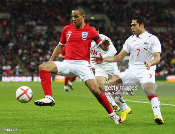 Theo Walcott of England shields the ball from Ahmed Fathy of Egyptduring the International Friendly match between England and Egypt at Wembley...