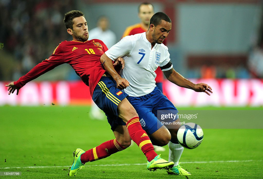Theo Walcott of England takes on Jordi Alba of Spain during the international friendly match between England and Spain at Wembley Stadium on November 12, 2011 in London, England.
