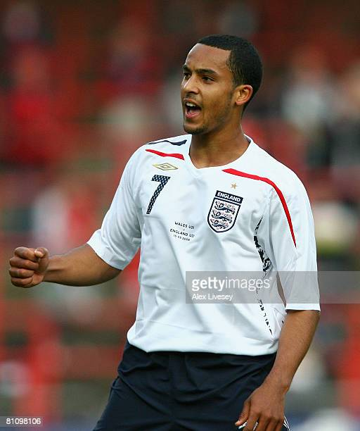 Theo Walcott of England U21 celebrates after scoring the second goal during the Nationwide Under 21 International Friendly between Wales U21 and...