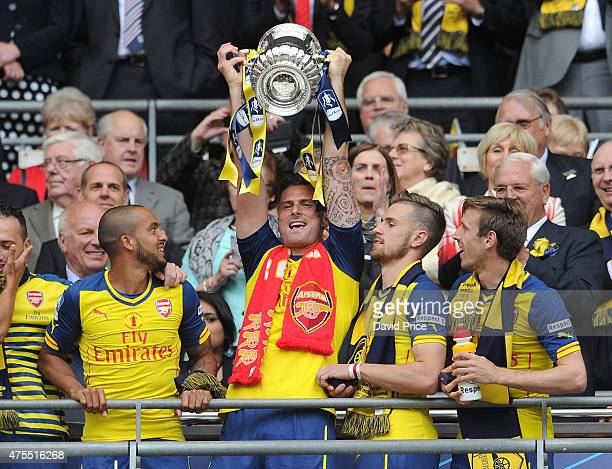 Theo Walcott Olivier Giroud Aaron Ramsey Nacho Monreal with the FA Cup Trophy after the match between Arsenal and Aston Villa in the FA Cup Final at...