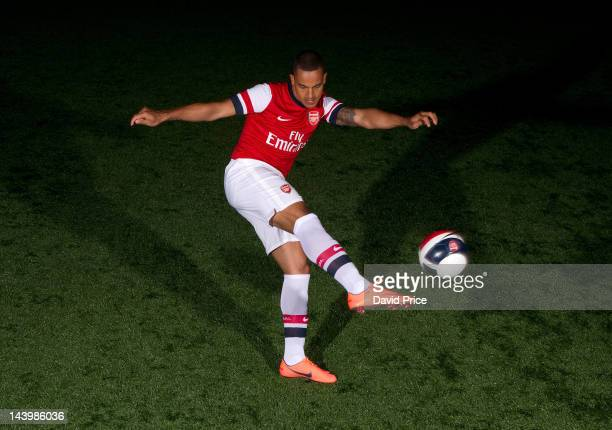 Theo Walcott poses during a photoshoot for the new Arsenal home kit for season 2012/13 at London Colney on April 5 2012 in St Albans England