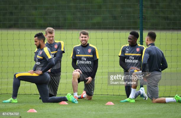 Theo Walcott Rob Holding Aaron Ramsey Danny Welbeck and Kieran Gibbs of Arsenal during a training session at London Colney on April 29 2017 in St...