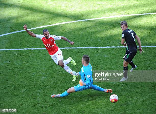 Theo Walcott scores a goal for Arsenal past Jack Butland of Stoke during the Barclays Premier League match between Arsenal and Stoke City on...