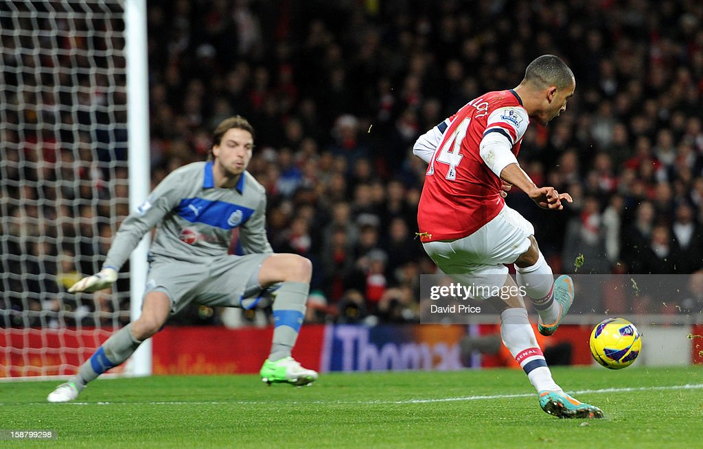 Theo Walcott scores Arsenal's 1st goal past Tim Krul of Newcastle during the Barclays Premier League match between Arsenal and Newcastle United at Emirates Stadium on December 29, 2012 in London, England.
