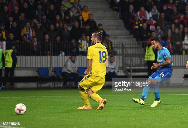 Theo Walcott scores Arsenal's 2nd goal under pressure from Igor stasevich of Bate during the UEFA Europa League group H match between BATE Borisov...