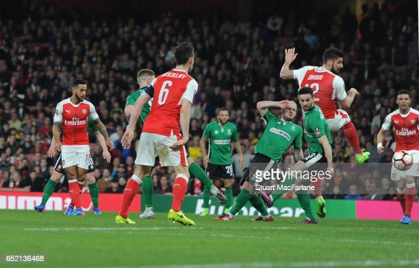 Theo Walcott scores for Arsenal during the Emirates FA Cup QuarterFinal between Arsenal and Lincoln City at Emirates Stadium on March 11 2017 in...