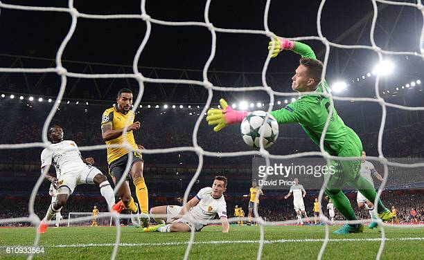 Theo Walcott scores his 1st goal for Arsenal past Tomas Vaclik of Basel during the UEFA Champions League match between Arsenal FC and FC Basel 1893...