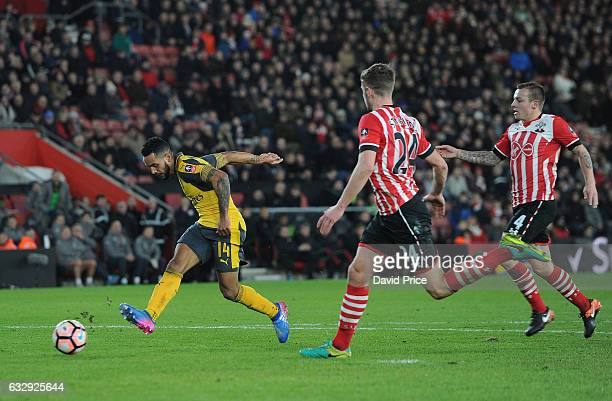 Theo Walcott scores his 3rd goal Arsenal's 5th during the match between Southampton and Arsenal at St Mary's Stadium on January 28 2017 in...