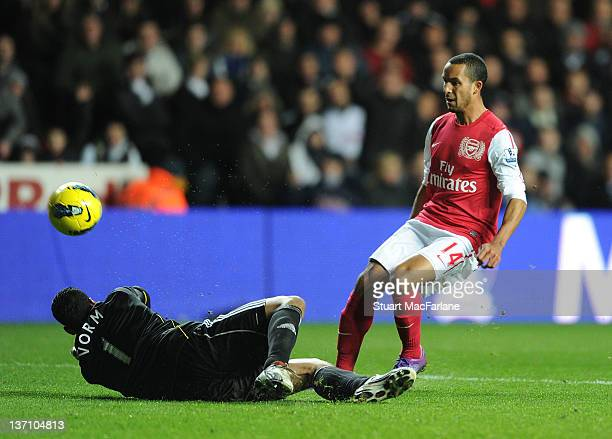 Theo Walcott shootas past Swansea goalkeeper Michel Vorm to score the 2nd Arsenal goal during the Barclays Premier League match between Swansea City...
