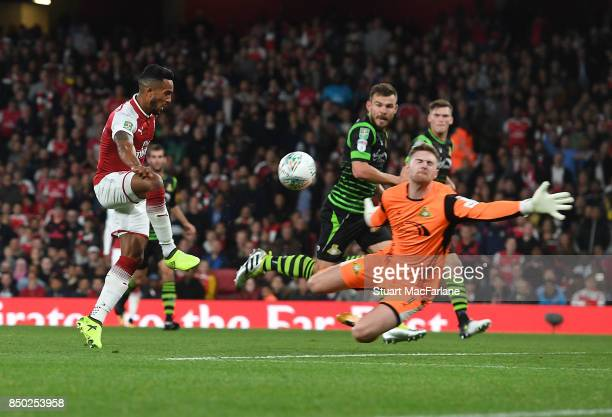 Theo Walcott shoots past Doncaster goalkeeper Ian Lawlor to score for Arsenal during the Carabao Cup Third Round match between Arsenal and Doncaster...