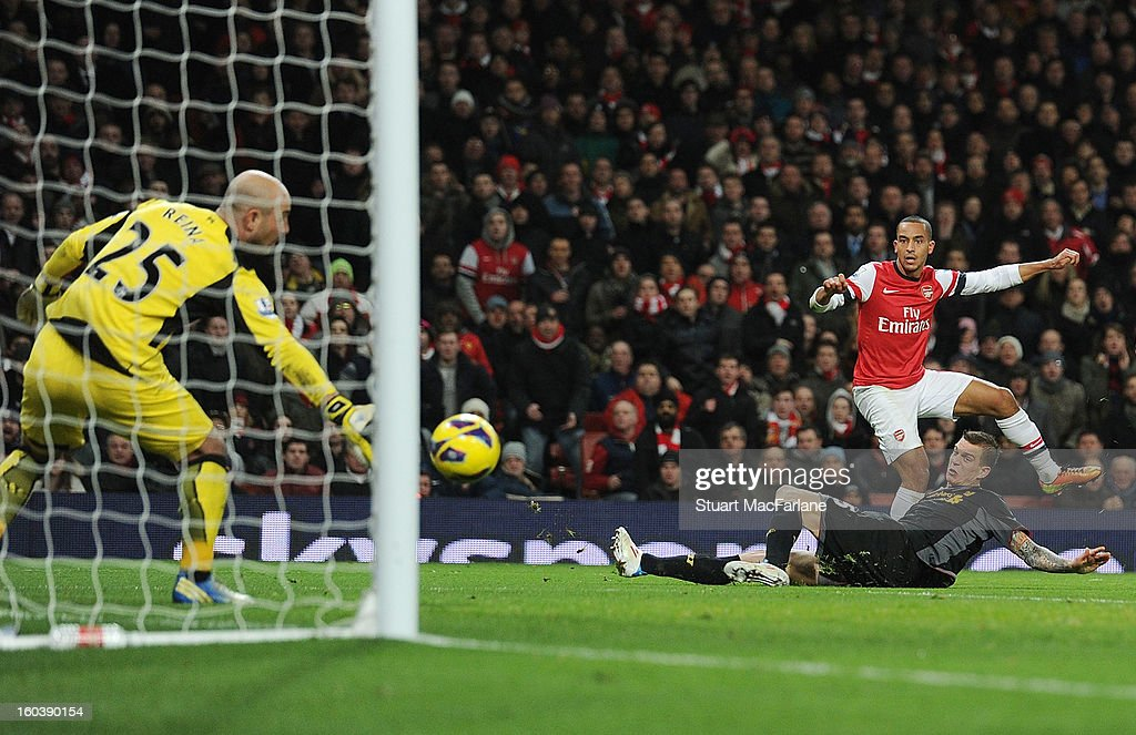 Theo Walcott shoots past Liverpool goalkeper Pepe Renia to score the 2nd Arsenal goal during the Barclays Premier League match between Arsenal and Liverpool at Emirates Stadium on January 30, 2013 in London, England.