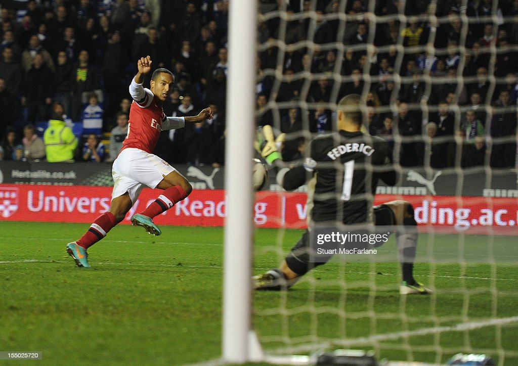 Theo Walcott shoots past Reading goalkeeper Adam Federici to score the fourth Arsenal goal during the Capital One Cup match between Arsenal and Reading at Madejski Stadium on October 30, 2012 in Reading, England.