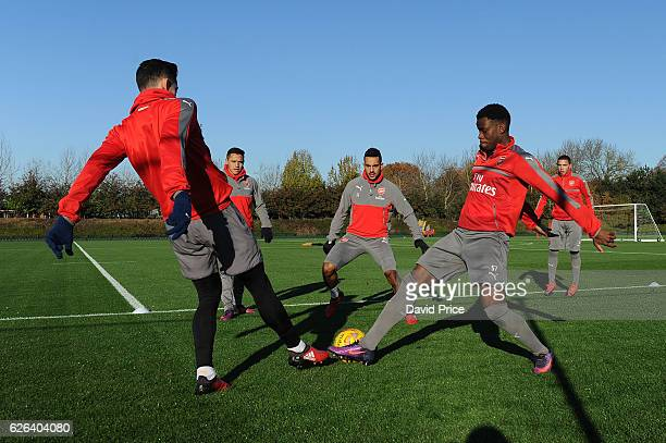 Theo Walcott Stephy Mavididi and Gabriel of Arsenal during Arsenal Training Session at London Colney on November 29 2016 in St Albans England