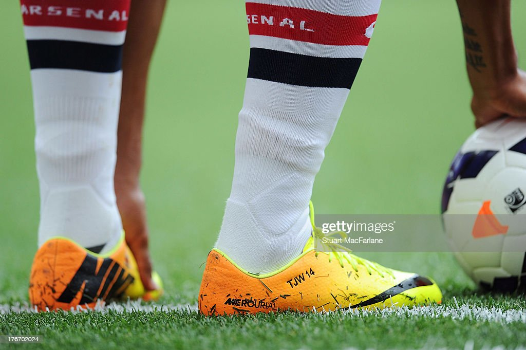 Theo Walcott's boots showing his initials and shirt number during the Barclays Premier League match between Arsenal and Aston Villa at Emirates Stadium on August 17, 2013 in London, England.