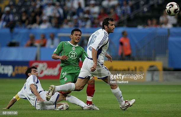 Theo Zagorakis and Ioannis Goumas of Greece and Jaime Lozano of Mexico during the Group B FIFA 2005 Confederations Cup match between Greece and...