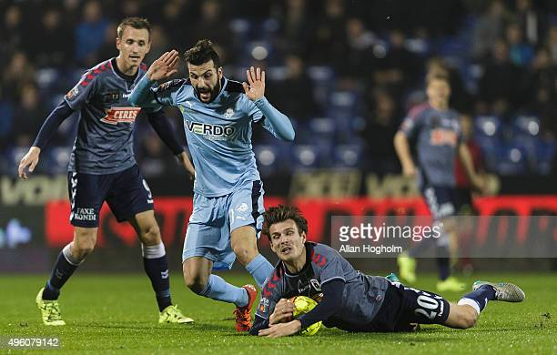 Theodor Elmar Bjarnason of AGF and Mikael Ishak of Randers FC compete for the ball during the Danish Alka Superliga match between Randers FC and AGF...