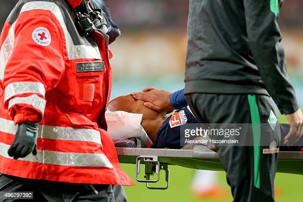 Theodor Gebre Selassi of Bremen is acrried on a stretcher after getting injured during the Bundesliga match between FC Augsburg and SV Werder Bremen...